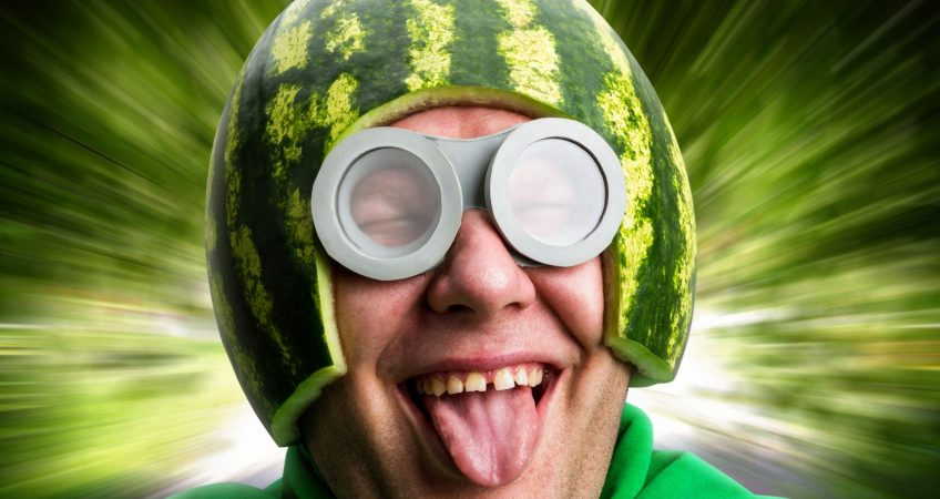 Pieptalk op-merk-elijk. funny man with watermelon helmet and googles looks like a parasitic caterpillar